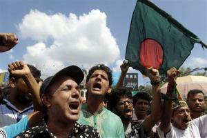 Bangladeshi activists shout slogans as they protest against the verdict of former Jamaat-e-Islami leader Ghulam Azam in Dhaka, Bangladesh, Monday, July 15, 2013.