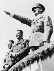 In this July 31, 1938, file photo, Adolf Hitler salutes a huge crowd at a sports meeting in Breslau, Germany.
