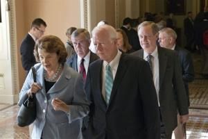 Senators walk to a closed-door meeting in the Old Senate Chamber for a showdown between Republican and Democratic leaders over presidential nominees that have been blocked by a GOP filibuster.