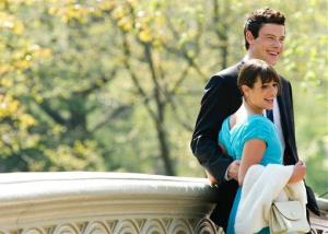 """Actors Lea Michele and Cory Monteith take a break between scenes while shooting the television show """"Glee"""" in Central Park in New York, Tuesday, April 26, 2011."""