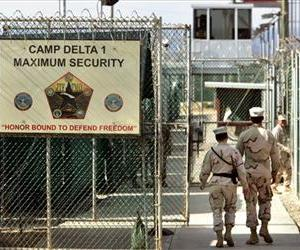 In this 2006 photo, US military guards walk within the military-run prison at Guantanamo Bay.