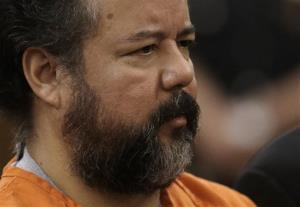 Ariel Castro stands before a judge during his arraignment on Wednesday.