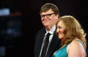 U.S. director Michael Moore and his wife Kathleen Glynn arrive for the premiere of the film ' Capitalism: a Love Story' at the Venice Film Festival Sunday, Sept. 6, 2009.
