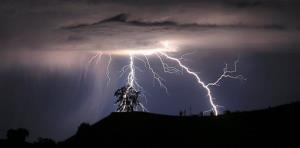 Lightning strikes above the Geysers area of northern Sonoma County, early Thursday, July 4, 2013 near Geyserville Calif.