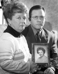 In this 2000 photo, Diane Dodd, left, and son Casey Sherman hold a photo in Rockland, Mass., of Dodd's sister Mary Sullivan.