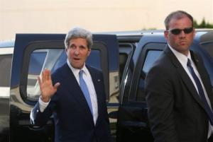 Secretary of State John Kerry waves to media as he arrives for a meeting with Palestinian President Mahmoud Abbas in the West Bank city of Ramallah on Friday.