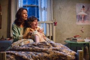 Lili Taylor portrays Carolyn Perron, left, and Joey King portrays Christine in a scene from The Conjuring.