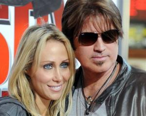 In this Jan. 9, 2010 file photo, Billy Ray Cyrus, at right, and his wife Laeticia Tish Cyrus, arrive to the premiere of The Spy Next Door in Los Angeles.