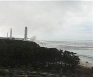 In this March 11, 2011 image taken from a footage released on Saturday, April 9, 2011 by TEPCO, a tsunami, center right to a tower, hits the sea side of the Fukushima Dai-ichi nuclear power plant.