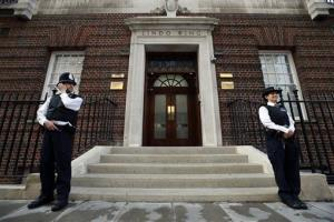 British police officers guard the entrance of St. Mary's Hospital exclusive Lindo Wing in London, Monday, July 22, 2013.