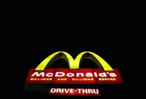 A McDonald's restaurant sign is illuminated.