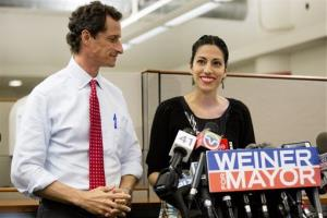 Huma Abedin, alongside her husband, New York mayoral candidate Anthony Weiner, speaks during a news conference Tuesday.