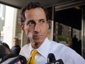 Anthony Weiner leaves his apartment building in New York, Wednesday, July 24, 2013.
