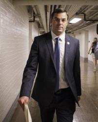 Rep. Justin Amash, R-Mich. walks through a basement tunnel to the House of Representatives on Capitol Hill Wednesday. His amendment to curb NSA powers failed, but it was close.