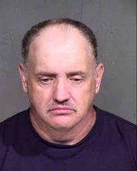 This image provided by the Maricopa County, Arizona, sheriff's office shows the booking photo of David Lee Simpson.
