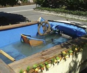 The photo provided by the police in Chemnitz on June 23, 2013 shows a car that has been converted into a driveable pool in Eibenstock, eastern Germany.