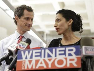In this July 23, 2013 photo, Huma Abedin, alongside her husband, New York mayoral candidate Anthony Weiner, speaks during a news conference at the Gay Men's Health Crisis headquarters in New York.