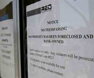 A No Trespassing sign is posted on a bank-owned foreclosed home in this file photo.