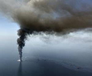 In this April 21, 2010, file photo, the Deepwater Horizon oil rig burns in the Gulf of Mexico.