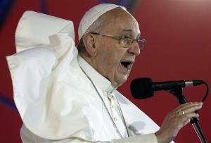 A gust of wind lifts the cape of Pope Francis as he speaks to the youth gathered at the World Youth Day Welcome Feast on the Copacabana beachfront in Rio de Janeiro, Brazil, Thursday, July 25, 2013.