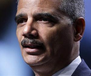 In this July 25, 2013 file photo, Attorney General Eric Holder speaks in Philadelphia. Holder tells Russia US won't seek death penalty for Edward Snowden.