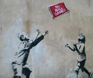 Banksy's 'No Ball Games' is seen in its original location in this screenshot from a YouTube video uploaded in 2009.