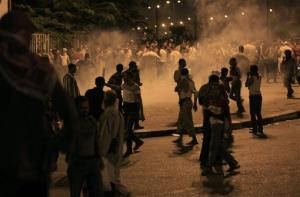 Supporters of Mohamed Morsi are seen in the smoke of tear gas fired by riot police during clashes.