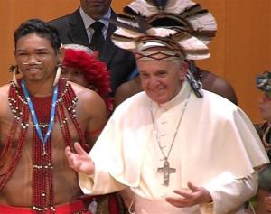 In this frame grab from video, Pope Francis wears an indigenous feather hat given to him by representatives of one of Brazil's native tribe in Rio de Janeiro.