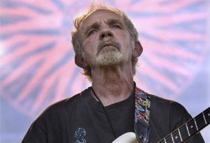 Singer-songwriter JJ Cale plays during the Eric Clapton Crossroads Guitar Festival.