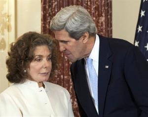 In this Feb. 6, 2013 file photo, Secretary of State John Kerry whispers to his wife Teresa Heinz Kerry during his ceremonial swearing-in as secretary of state.