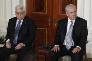 Israel's Prime Minister Benjamin Netanyahu, right, and Palestinian President Mahmoud Abbas are seated together at the White House.
