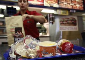 A kid's meal of macaroni and chocolate milk is served by a worker at Burger King with a toy in San Jose, Calif., Tuesday, April 27, 2010