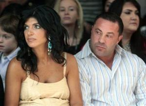 This Sept. 13, 2009 file photo originally released by Oral-B Pulsonic shows Real Housewives of New Jersey stars Teresa Giudice and her husband Joe Giudice in New York.