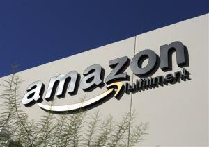 In this 2010 file photo, the Amazon.com logo adorns an Amazon facility in Goodyear, Ariz.