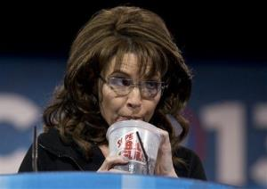 Former Alaska Gov. Sarah Palin drinks from a 7-Eleven Super Big Gulp on stage while speaking at the 40th annual Conservative Political Action Conference.