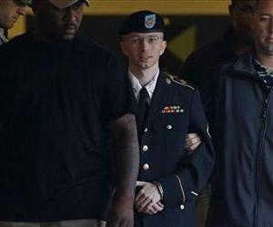 Army Pfc. Bradley Manning is escorted to a security vehicle outside of a courthouse in Fort Meade, Md., Monday, July 29, 2013, after the third day of deliberations in his court martial.