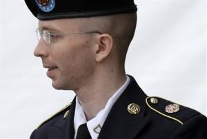 In this July 30, 2013 file photo, Army Pfc. Bradley Manning is escorted out of a courthouse in Fort Meade, Md. after receiving a verdict in his court martial.