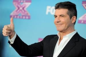 Simon Cowell attends the The X Factor season finale results show at CBS Television City on Thursday, Dec. 20, 2012, in Los Angeles.