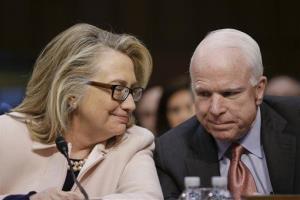 Secretary of State Hillary Rodham Clinton huddles with. John McCain.