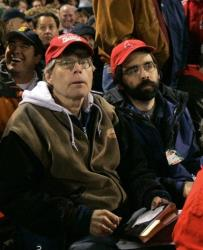 Stephen King watches with his son, Joe Hill, during Game 1 of the American League Championship baseball series between the Cleveland Indians and Boston Red Sox, Oct. 12, 2007, at Fenway Park in Boston.