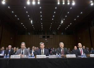 Top intelligence officials prepare to testify before the Senate Judiciary Committee.