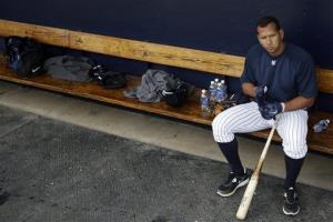 New York Yankees' Alex Rodriguez sits in the dugout during practice.