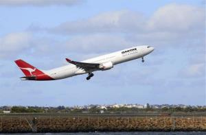 A Qantas jetliner takes off from Sydney Airport in Sydney, Monday, Oct. 31, 2011.