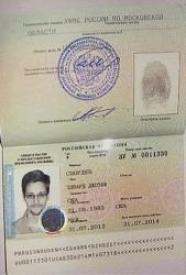This image taken from Associated Press Television shows a copy of a temporary document to allow Edward Snowden to cross the border into Russia.