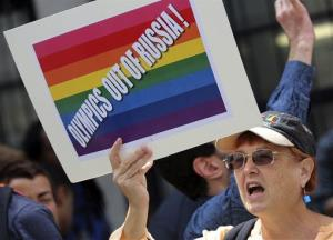 A gay rights activist chants slogans during a demonstration in front of the Russian consulate in New York, Wednesday, July 31, 2013.