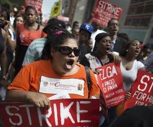 Demonstrators in support of fast food workers march towards a McDonald's as they demand higher wages and the right to form a union without retaliation, July 29, 2013, in New York's Union Square.
