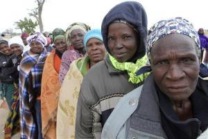 Zimbabweans wait to cast their votes in Harare on Wednesday.