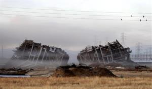 The dust clears the two remaining towers of the old Kern Power Plant after the implosion knocked them to the ground.