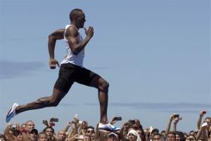 Usain Bolt runs in a 150-meter race in Brazil in March.