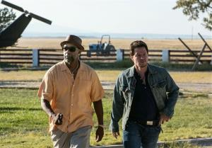 This image released by Universal Pictures shows Denzel Washington, left, and Mark Wahlberg in a scene from 2 Guns.